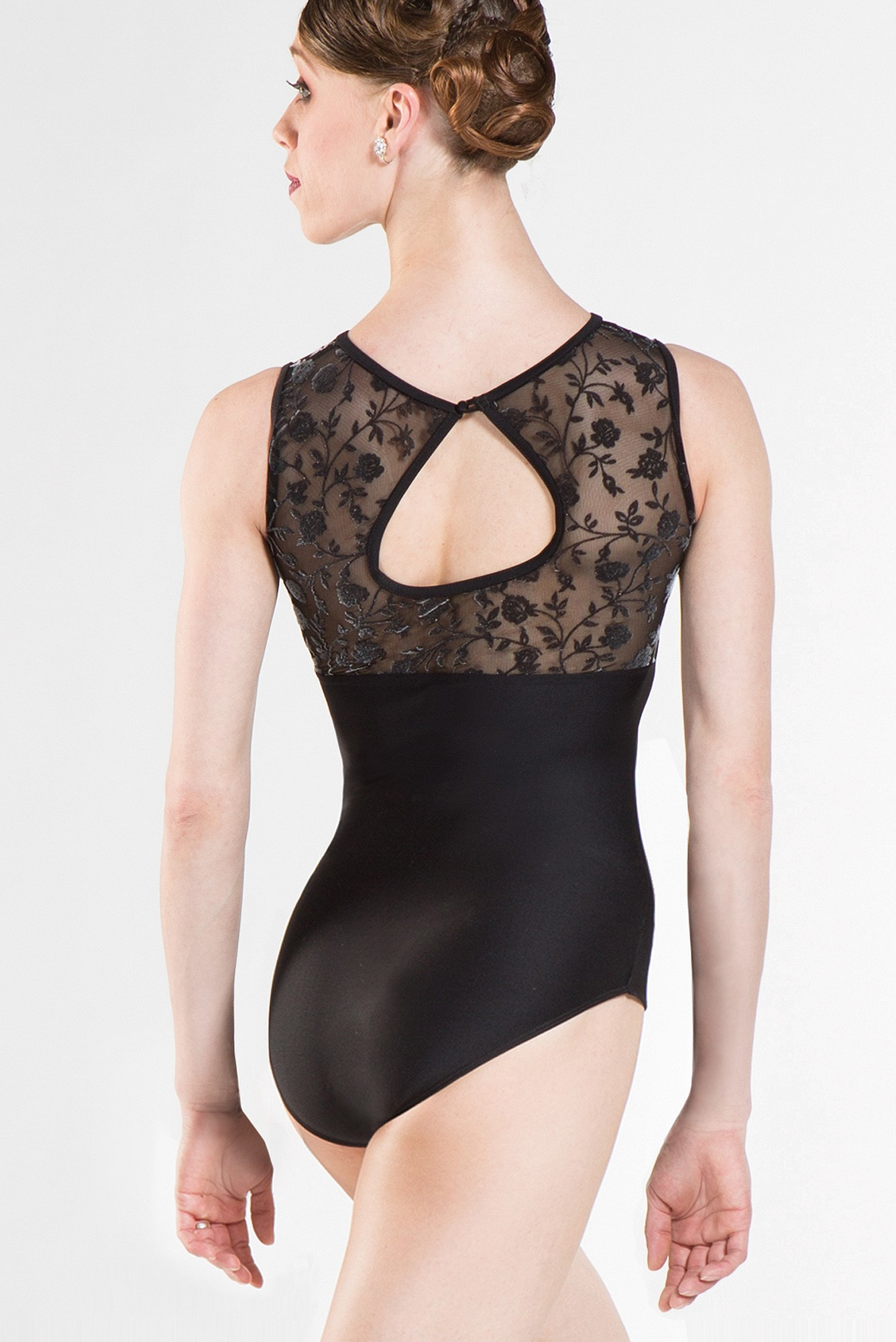 Wear Moi Majeste. The faux sweetheart line of this soft and comfortable leotard is complimented with a one button closure on the back of the neck, creating a key-hole look. Featuring 3-D flocked stretch tulle and soft microfiber. Fully front lined.